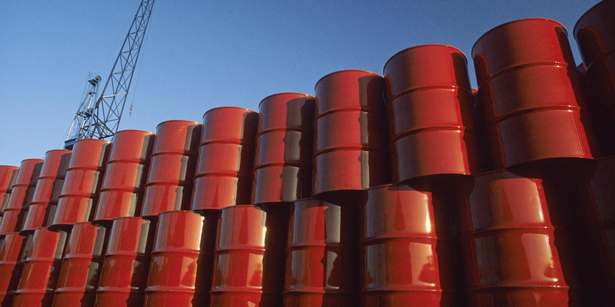 Red metal barrels against blue sky.